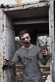image of insane  - Zombie man shouting like insane in agony - JPG