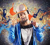 stock photo of pentagram  - Boy listening and dancing to hiphop music - JPG