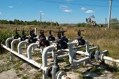 picture of gas-pipes  - oil and gas processing plant with pipe line valves - JPG
