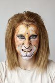image of face painting  - Young blond slav girl with face painting lion - JPG