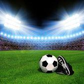 Постер, плакат: Soccer ball and shoes