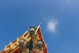pic of apex  - the gable apex with small bell and lantern with sky background - JPG