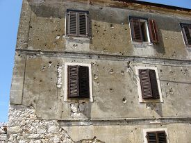 stock photo of former yugoslavia  - signs of war on a house inhabited by ordinary people of the country of the former Yugoslavia - JPG