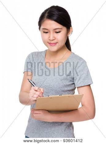 Asian girl take note on clipboard