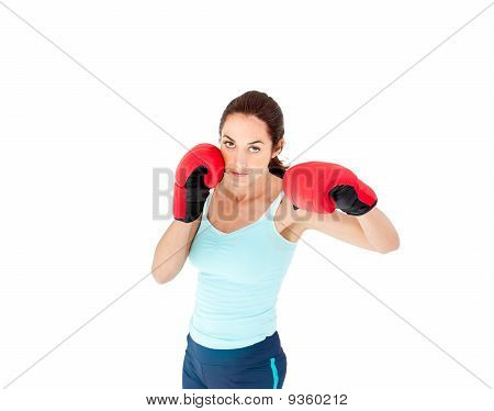Concentrated Hispanic Woman With Boxing Gloves Working Out