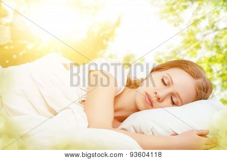 Concept Of Rest And Relaxation. Woman Sleeping In Bed On The Background Of Nature