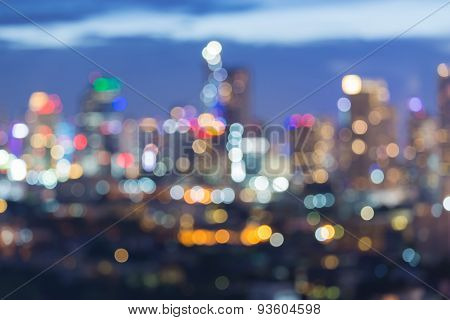 Blur bokeh city lights with clear blue sky