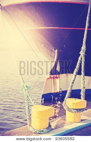Vintage Stylized Yellow Bollard Holding Ship Moored.