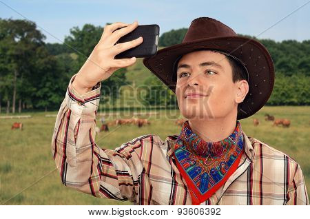 Cowboy taking a picture of himself