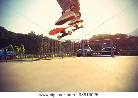 skateboarder legs doing a ollie at skateparkvintage effect