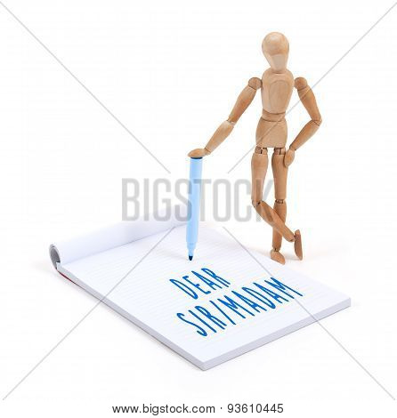Wooden Mannequin Writing In Scrapbook - Dear Sir Madam