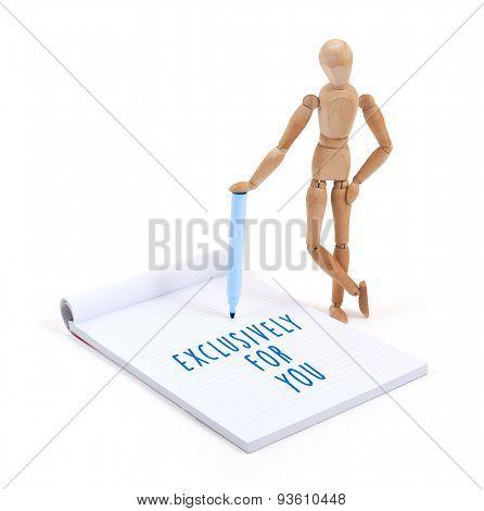 Wooden Mannequin Writing In Scrapbook -