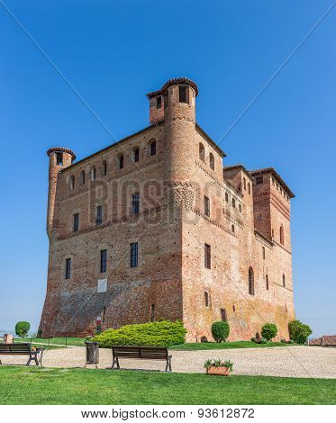 Old castle under blue sky in Piedmont, Northern Italy.