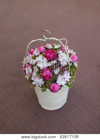 A Bouquet Of Artificial Flowers On The Table.