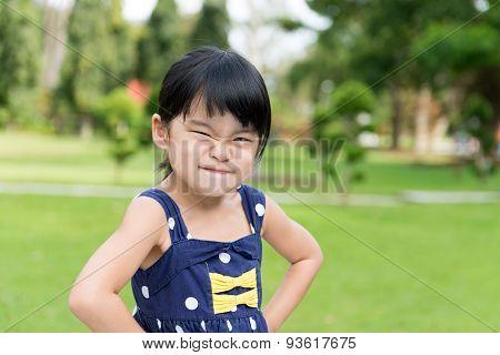 Little Asian Girl In The Park
