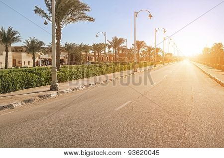 Empty Street In City At Sunset