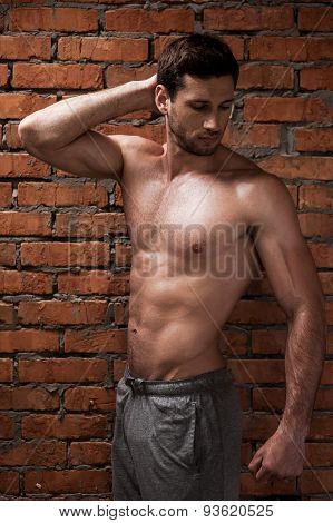 Handsome young muscular man posing