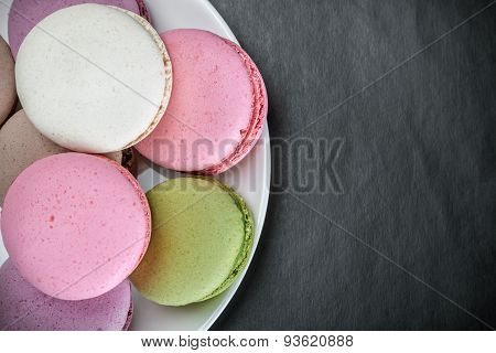 Sweet And Colourful French Macaroons On A Black Background