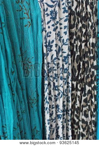 Scarves hanging in turquoise and blue floral pattern