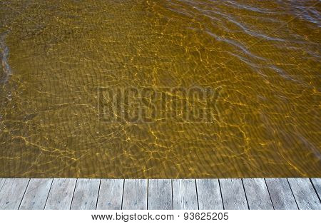 Yellow ocean water discolored by clean sediments
