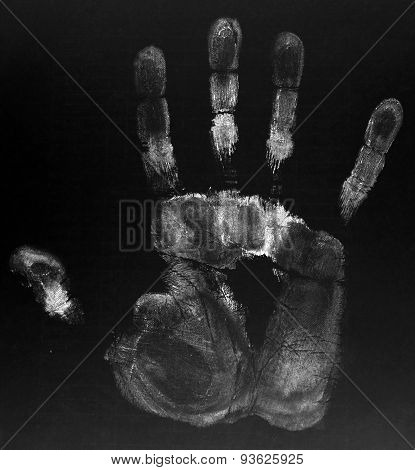 Hand print on black background