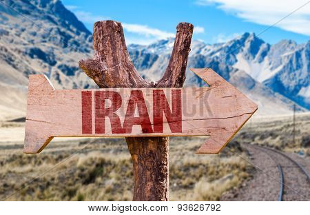 Iran wooden sign with desert road background