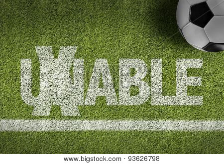 Soccer field with the text: Unable/Able