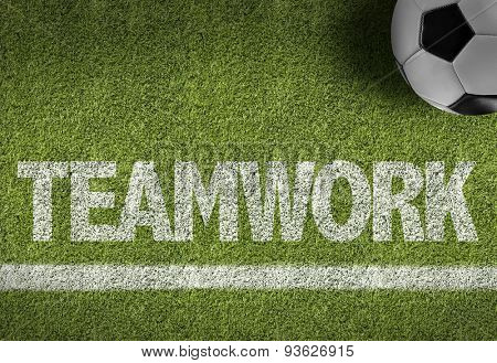 Soccer field with the text: Teamwork