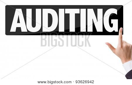 Businessman pressing button with the text: Auditing