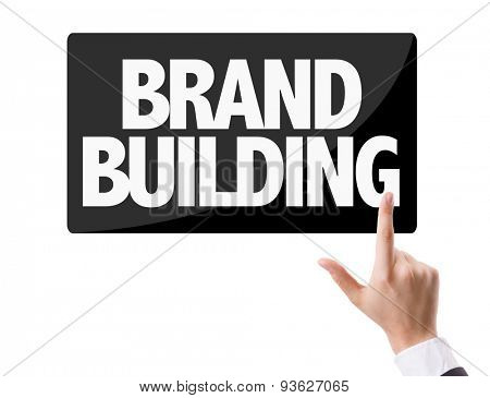 Businessman pressing button with the text: Brand Building