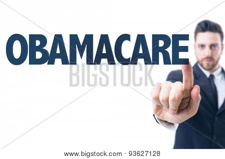 Business man pointing the text: Obamacare