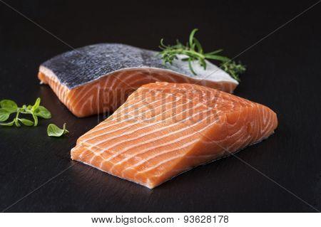 Salmon filet on a black slab of slate