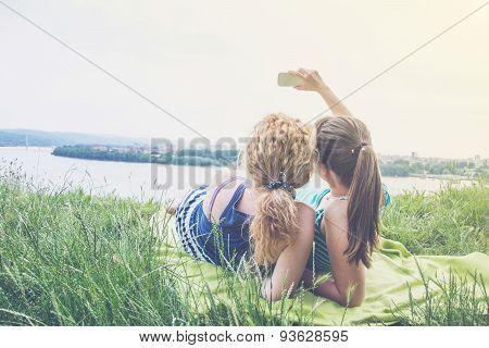 Two Best Girl Friends Taking Selfie