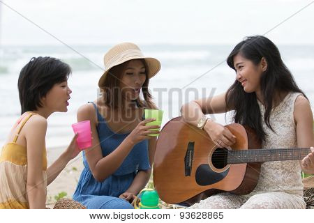 Portrait Of Asian Woman And Friends Group Playing Guitar And Happiness Singing A Song Use For People