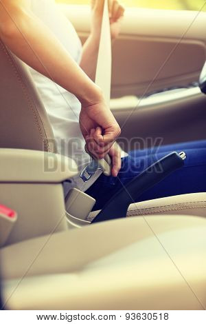 woman driver buckle up the seat belt before driving car,vintage effect