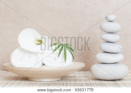 white towels calla lilly and massage stones