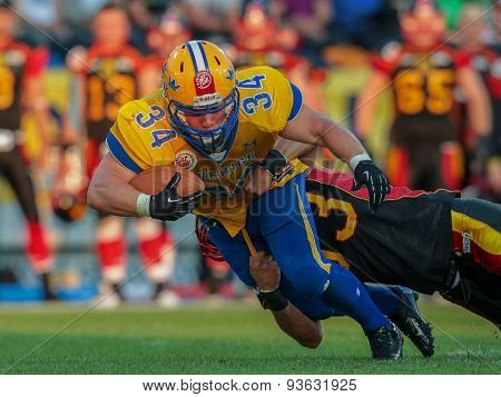 ST. POELTEN, AUSTRIA - JUNE 3, 2014: RB Jonathan Wikstrom (#34 Sweden) is tackled by an opponent during the Football EC European Championchip in St Poelten, Austria.