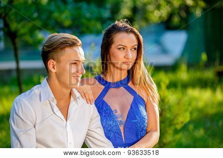 beautiful young couple in park in a summer day