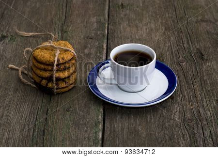 Cup Of Coffee And Nearby Linking Of Oatmeal Cookies