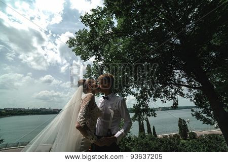 Couple on a background of lake