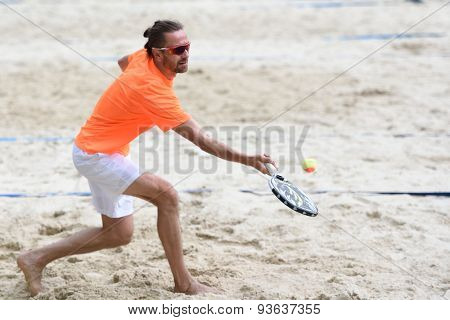 MOSCOW, RUSSIA - MAY 31, 2015: Sergey Kuptsov in the match of Russian beach tennis championship. 120 adults and 28 young athletes compete in the tournament