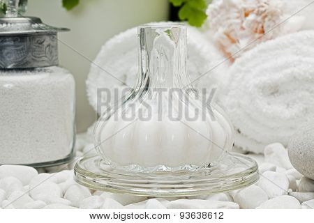 bottle with milky lotion spa treatment product