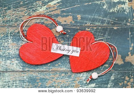 Missing you card with two red wooden hearts