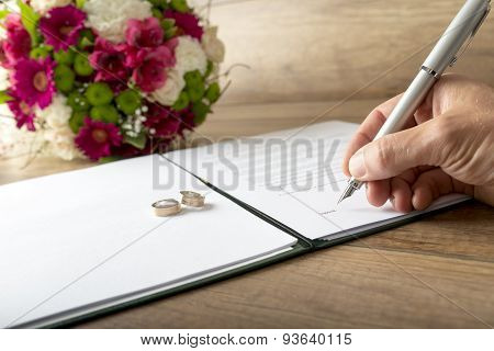 Man Signing A Marriage Register