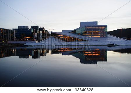 Oslo new Opera House on the dawn reflecting in the water