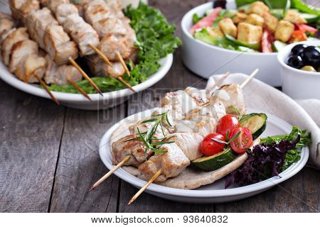 Pork kebabs on pita with vegetables