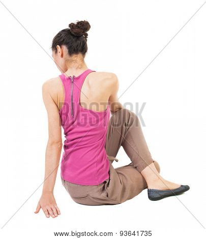 Back view of the girl sitting in front of a warm up exercise.  Rear view people collection.  backside view of person.  Isolated over white background. African-American woman performs stretching yoga