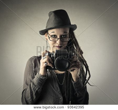 Young photographer using a professional camera