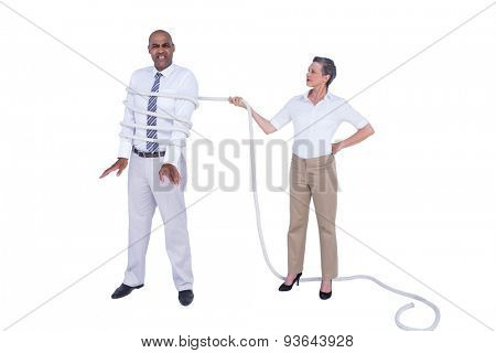 Businesswoman tying up businessman on white background