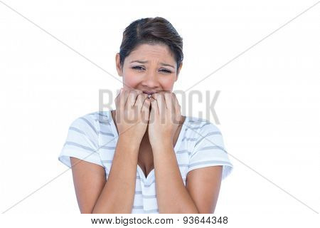 A sad brunette with ache on white background